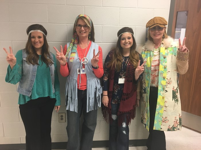 Mrs. Alsip, Mrs. Floyd, Ms. Smith, and Ms. Greer are celebrating the 70th day of School is their 70s outfits!
