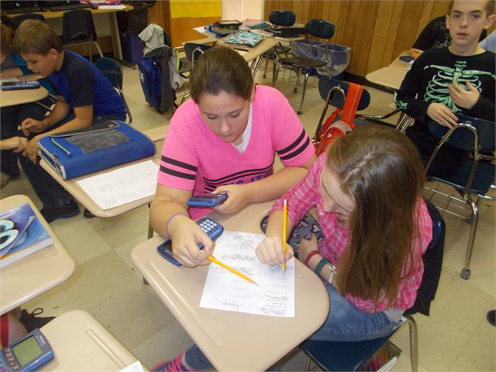Mrs. Jones' 7th grade math students working percentage word problems using Kagan structures in class.