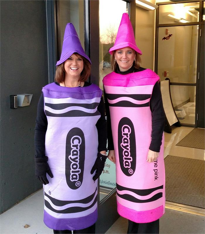 Mrs. Jones and Mrs. Smith dressed up as the Purple and Pink Crayola Crayons!